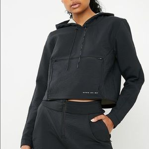 NIKE Tech Pack Cropped Pullover Hoodie in Black